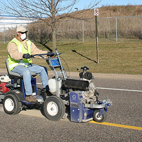 Scarifier machines for removing traffic paint